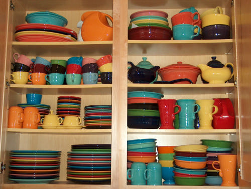 Fiestaware on cream kitchen shelves